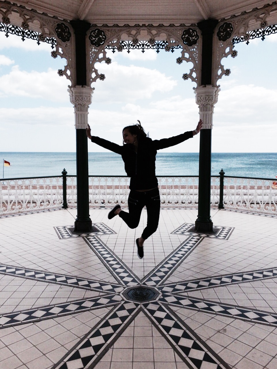 girl jump sky brighton england sea view seaside beach waves