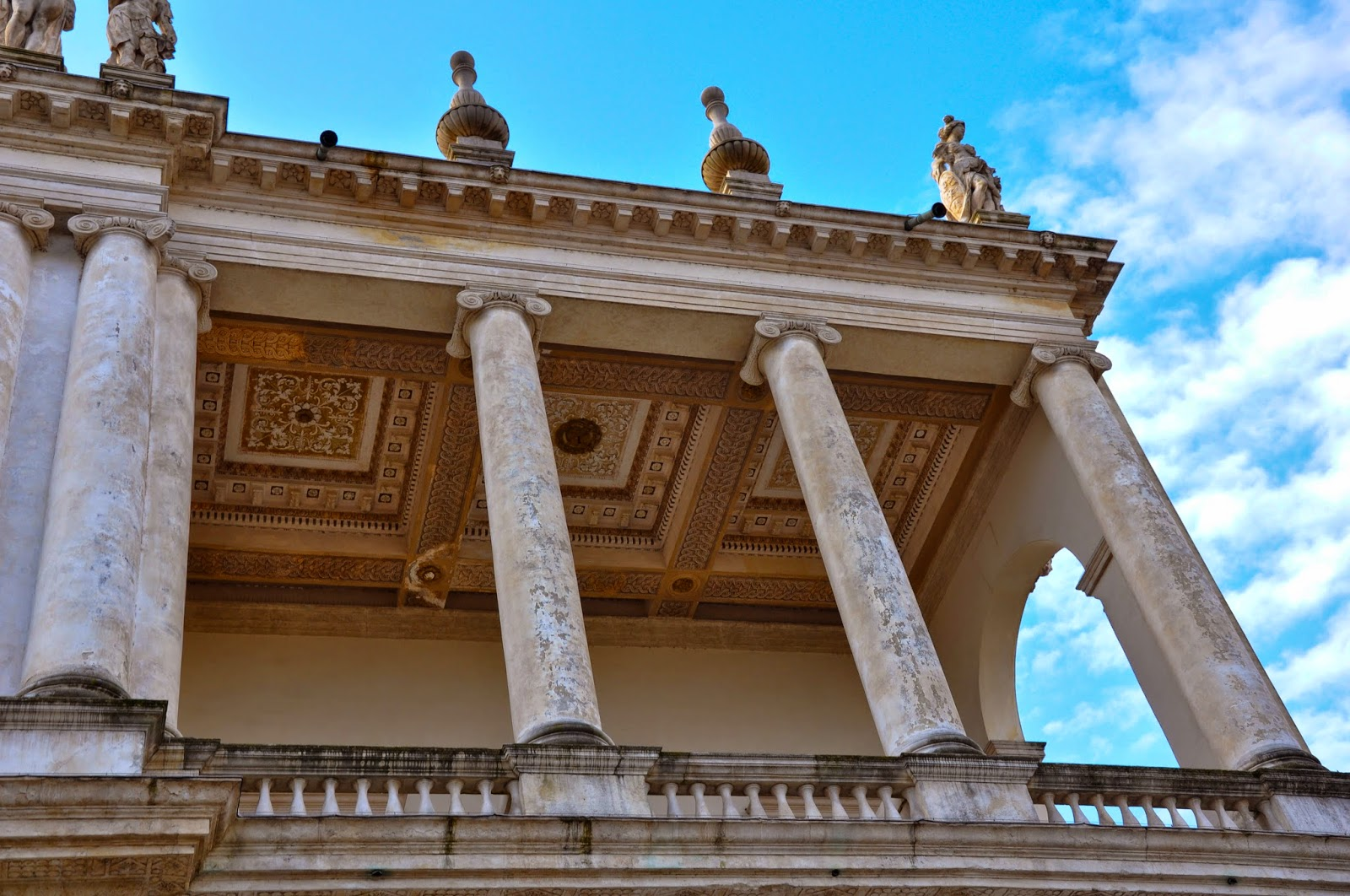 The upper balcony of Palazzo Chiericati in Vicenza, Italy against the blue skies of Veneto