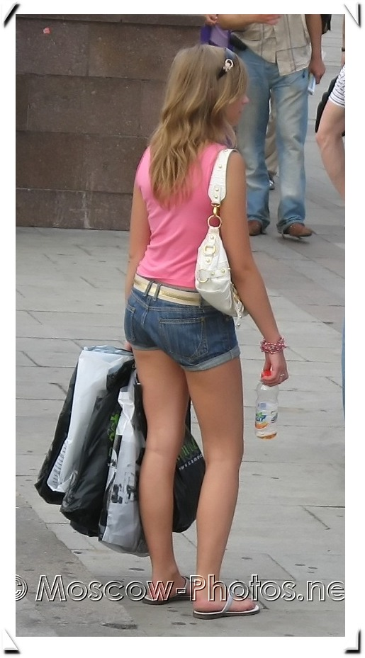 Girl in pink tank and denim shorts
