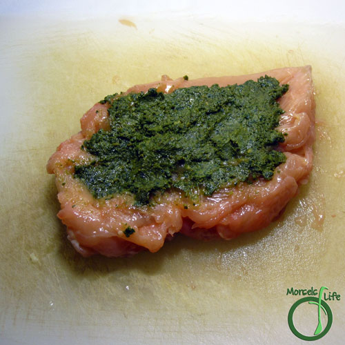 Morsels of Life - Pesto Stuffed Chicken Step 2 - Spread pesto on inside of chicken breast.