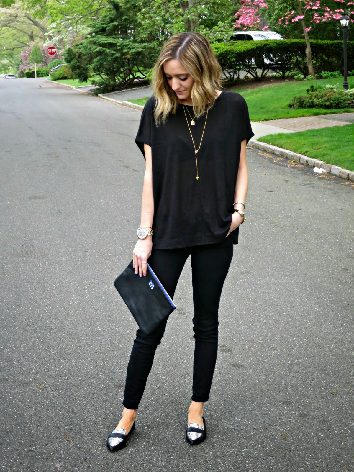 black outfit with gold jewelry