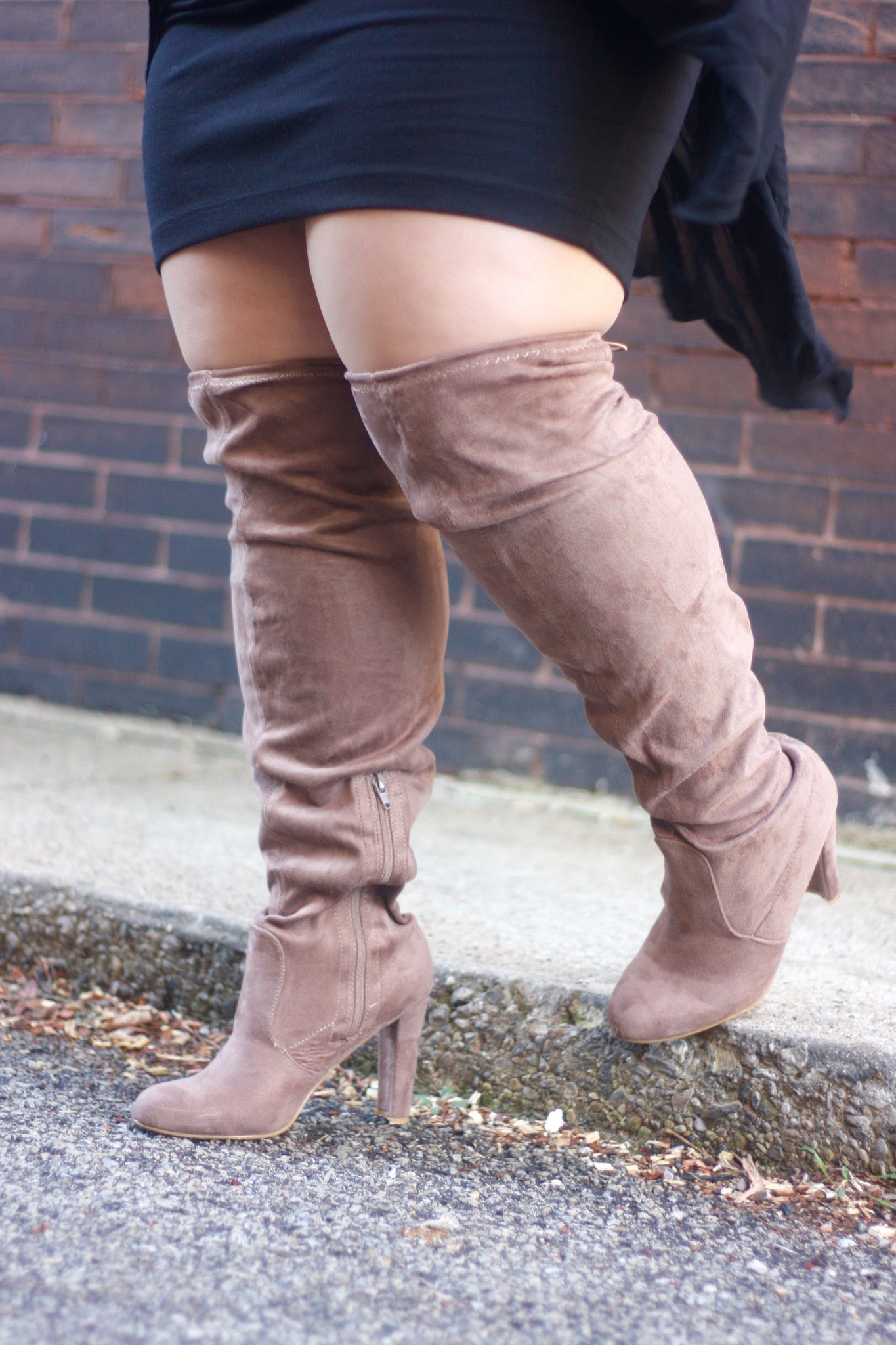 Natalie in the City shares cute thigh high wide calf boots and styles a plus size dress with knee high boots.