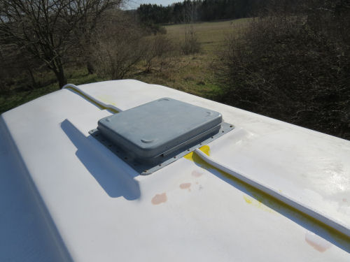 section of Trim Loc covering a seam on a fiberglass trailer