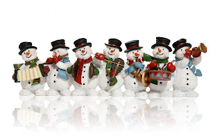 Christmas-snowman-family-band-playing-different-musical-instruments.jpg