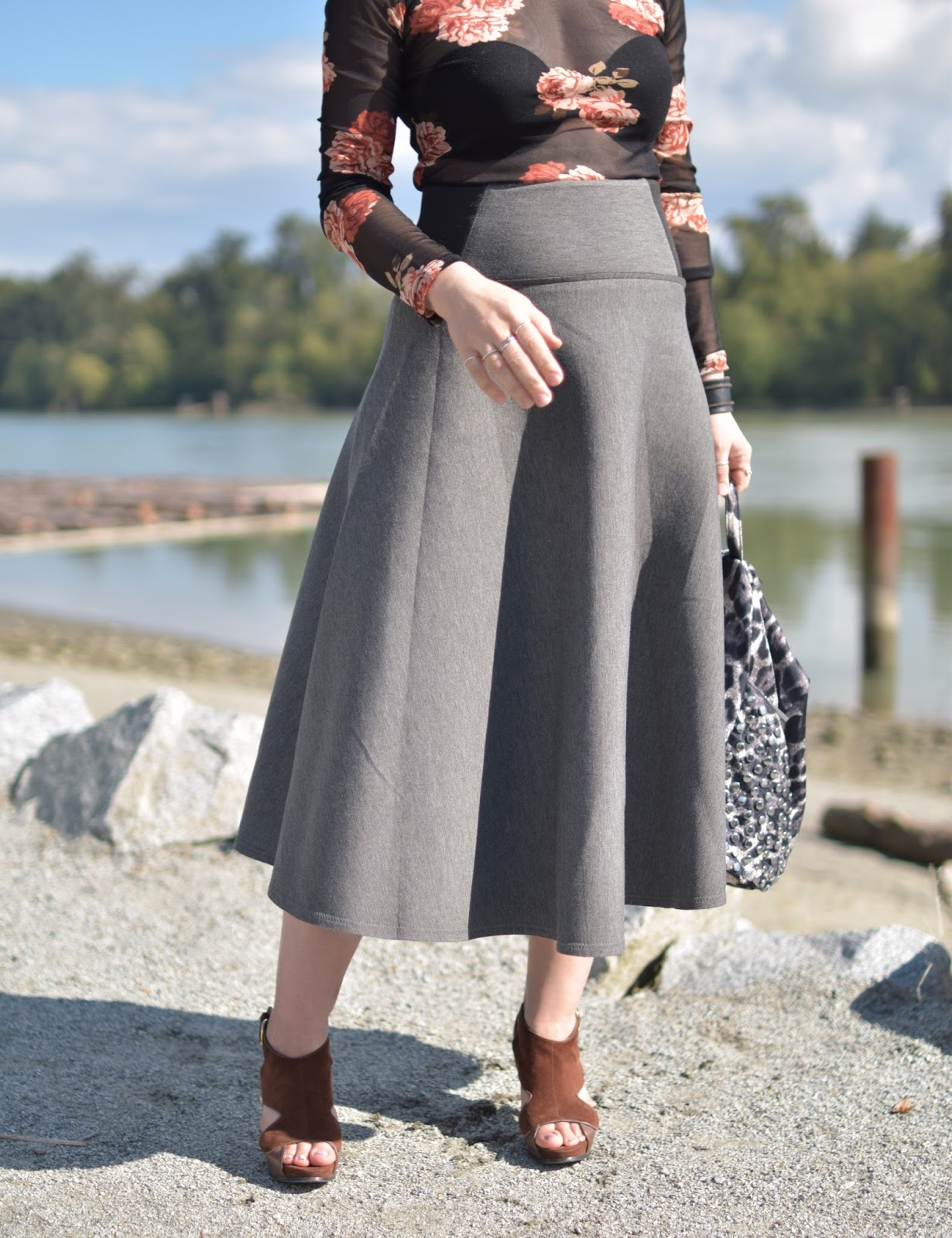 flared midi skirt, sheer floral top, suede platform heels, leopard-print backpack