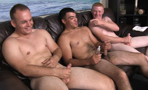 Group of men masturbating