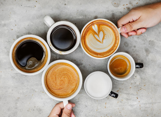 Six coffee cups with two hands