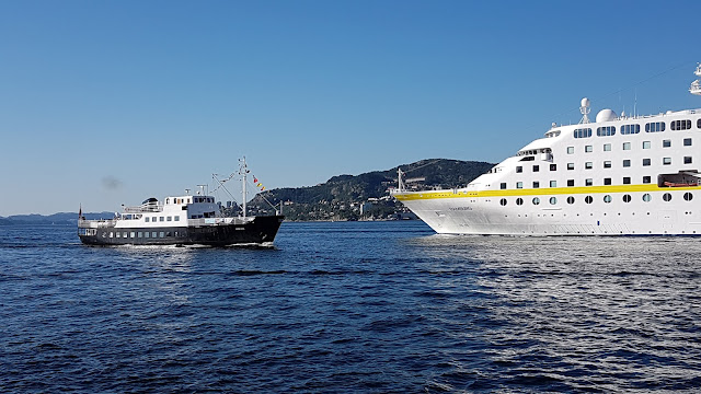 Cruise ship MS Hamburg departing a sunny Bergen, Norway