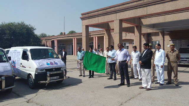 District Magistrate Mr. N P Singh flagging off the vehicles
