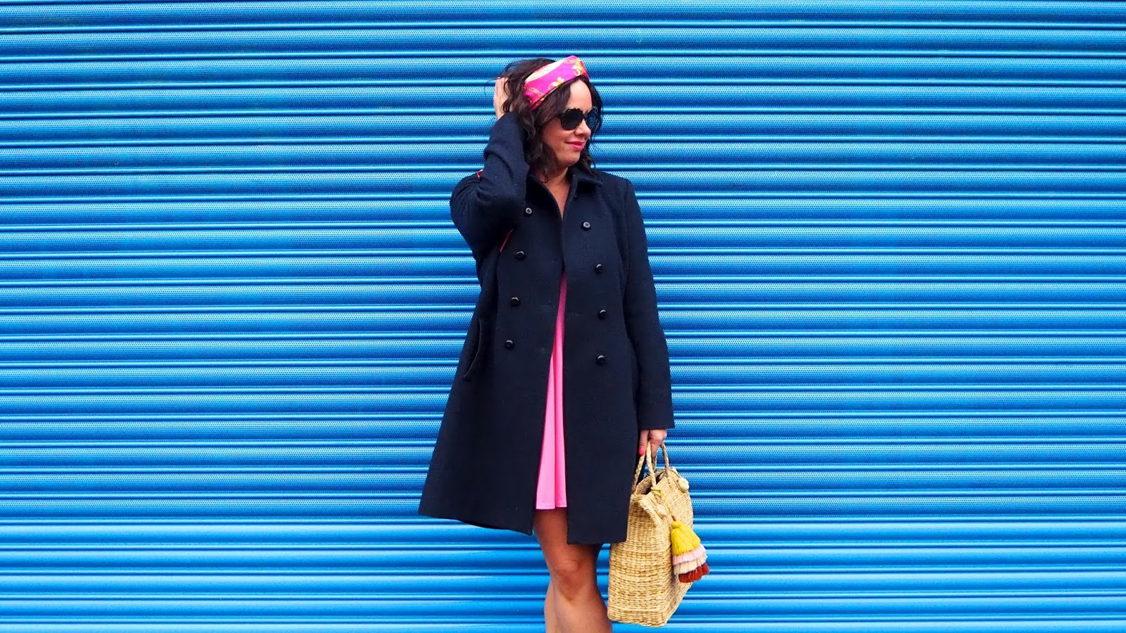 Pink dress, navy coat and chain print headscarf