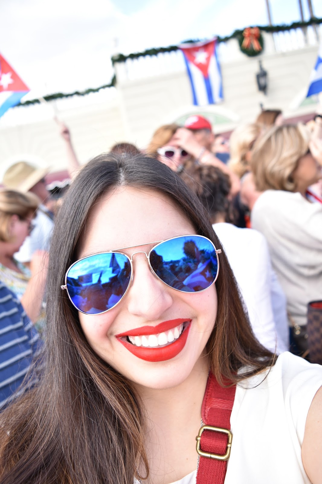 blue aviators, red lipstick