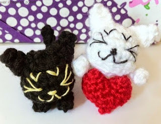 http://www.craftsy.com/pattern/crocheting/toy/little-sleepy-cats-in-love/44403