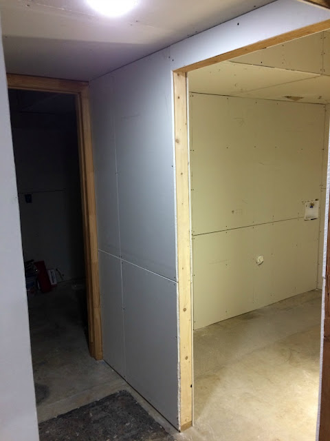 See what a difference drywall and lighting made in our basement!