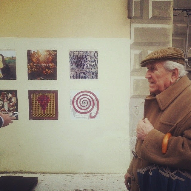 Old man from Montalcino looking at the latest vintage tiles