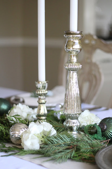 holiday tablescape mercury candleholders ornaments greens hydrangeas
