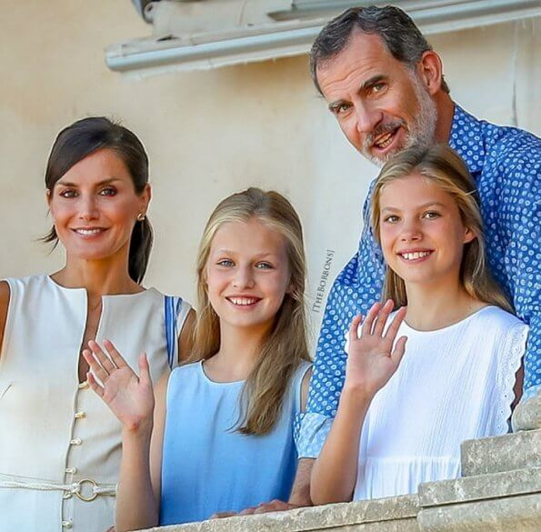 King Felipe, Queen Letizia, Crown Princess Leonor and Infanta Sofia. Queen Letizia wore Mango linen blend midi dress gold buttons