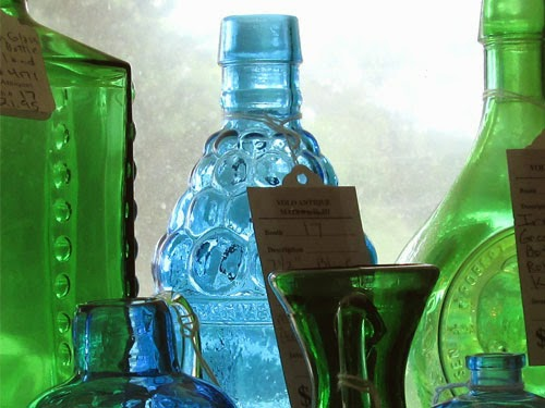 wintage blue and green bottles
