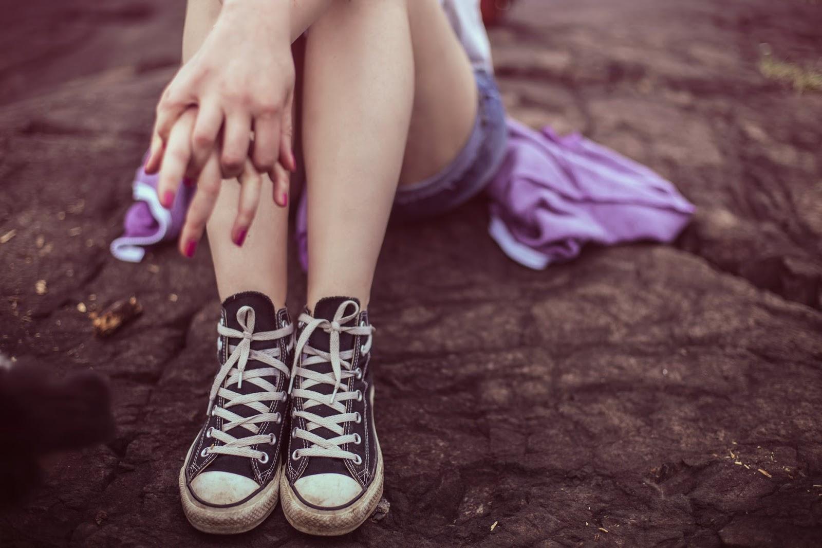 teenager wearing shorts and converse