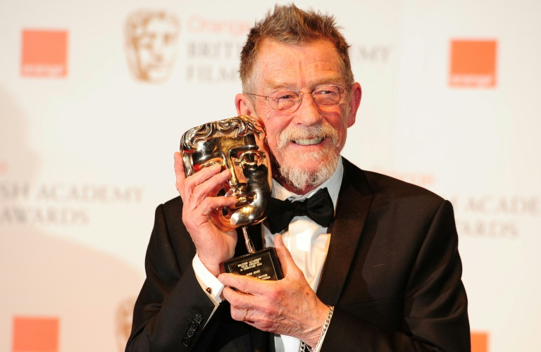 John Hurt poses with his award for outstanding British contribution at the BAFTA awards in February, 2012