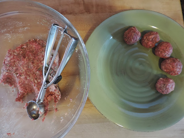 The meatballs being formed with a small scoop.