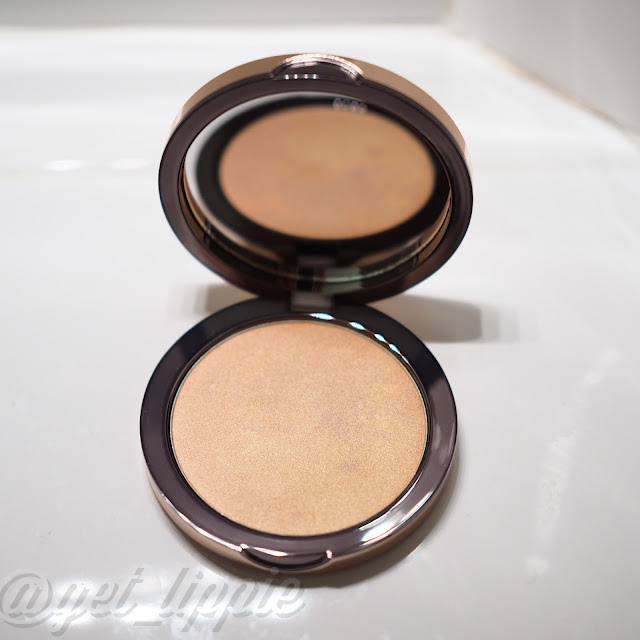 Delilah Pure Light Illuminating Powder in Aura