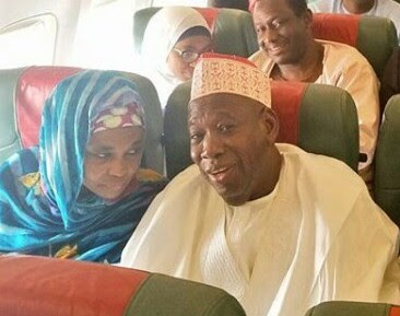 Photo: Governor Abdullahi Ganduje and his wife spotted on the economy wing of Kano-bound flight