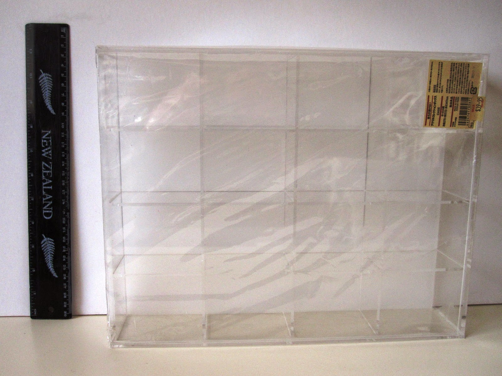 Muji display box with ruler next to it.