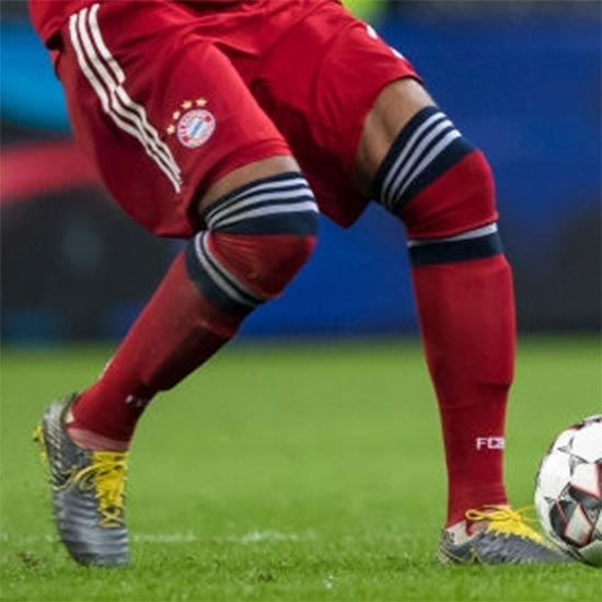 3860f45f717 Jerome Boateng Wears Extremely Odd Double Socks Style - cheap soccer ...