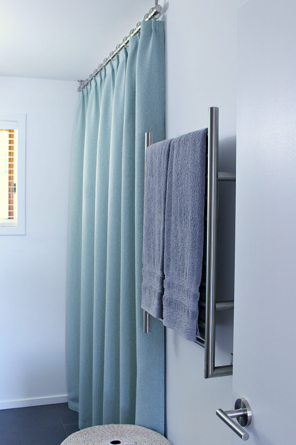 Ceiling Mounted Shower Curtain Rod + Turquoise Tweed Pleated Shower Curtain in Modern Bathroom Reno | www.danslelakehouse.com