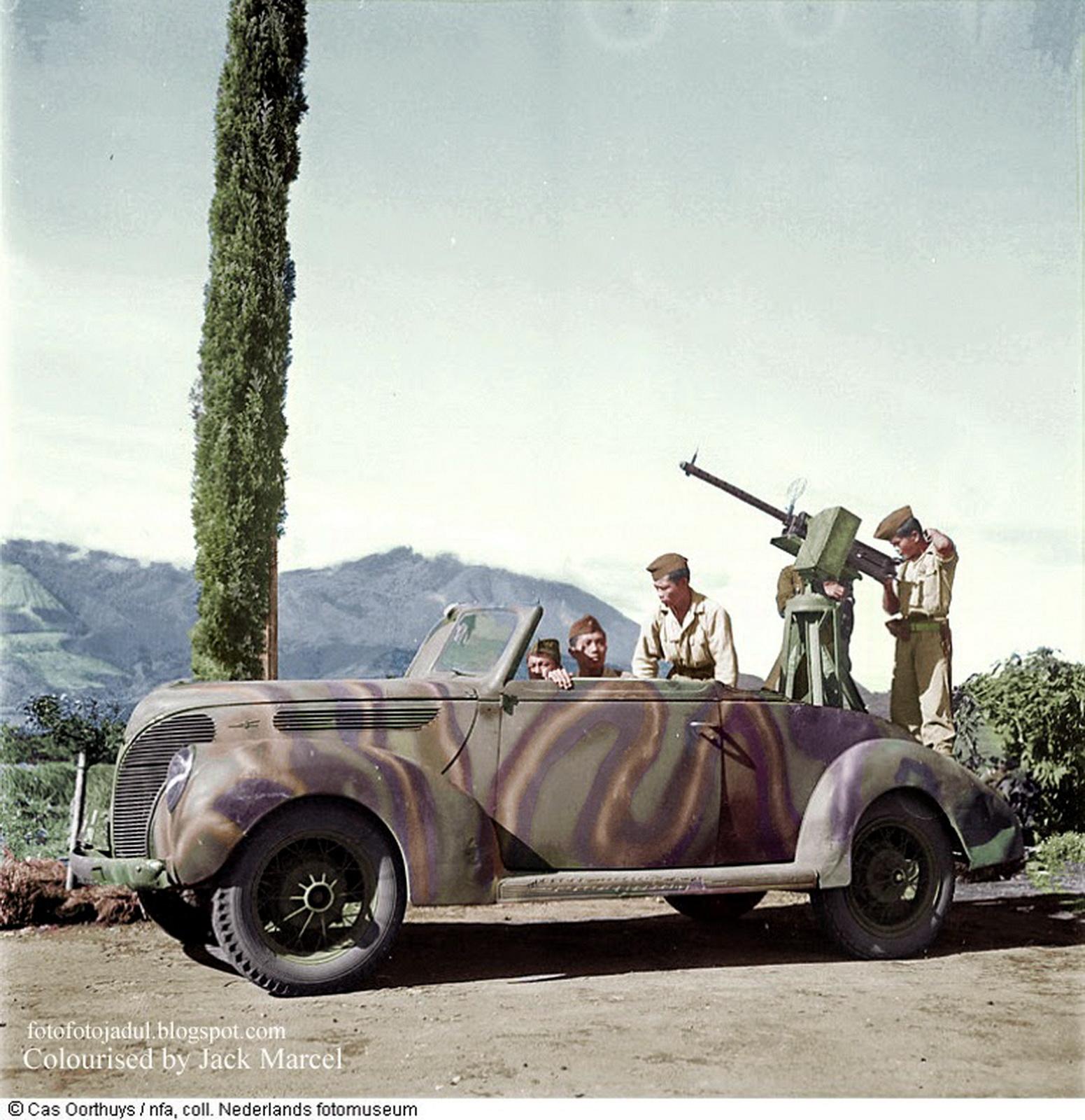 OLD INDONESIAN VEHICLES: AA Gun Mounted on an Open Passenger Car