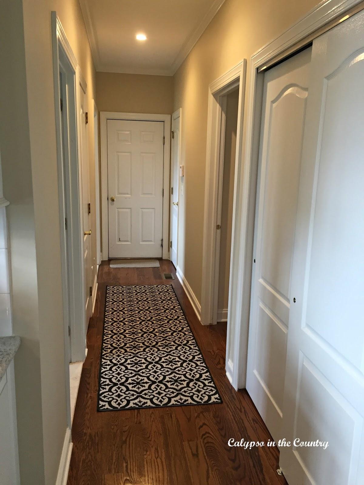Hallway with tile-look runner