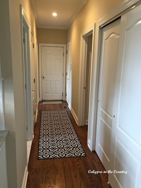 Hallway with tile-look runner