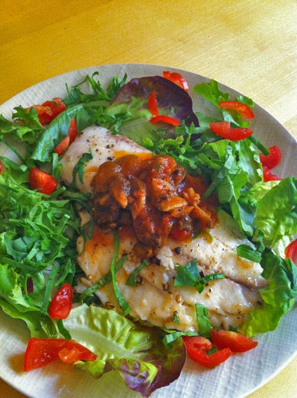 Mixed greens and tilapia Salad with tomato basil mushroom sauce