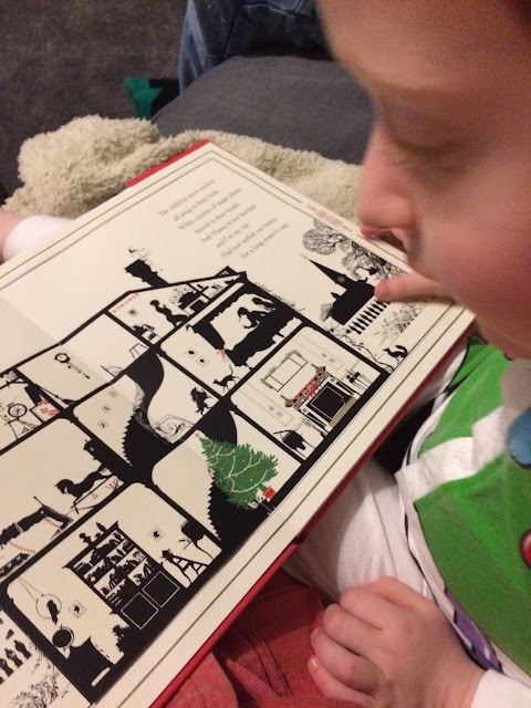 A child reading The Night Before Christmas