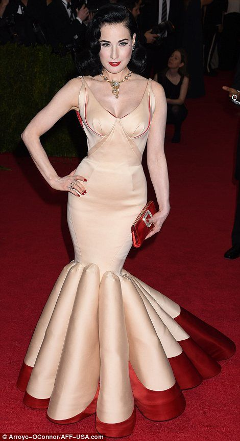 Dita von Teese in a gold and red Zac Posen gown at the Met Gala 2014