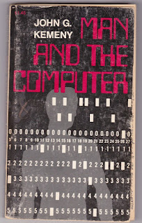 Book cover shows silouette of man behind computer's punched card