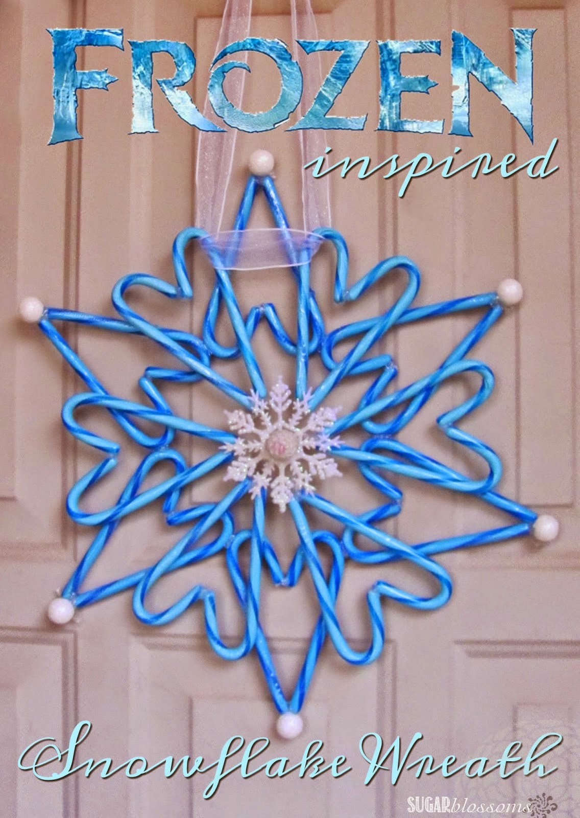 http://sweetsugarblossoms.blogspot.com/2014/12/frozen-inspired-snowflake-wreath.html