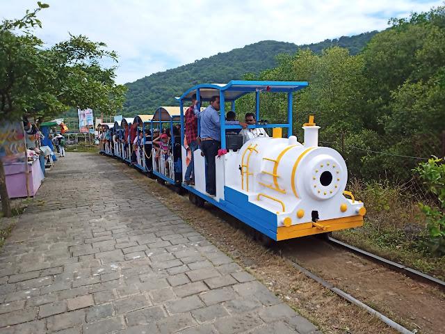 Toy train on Elephanta Island with passengers