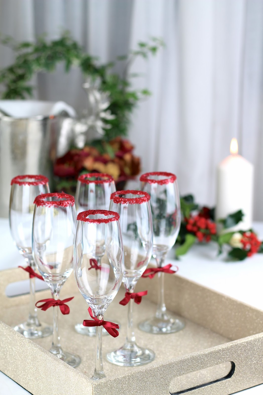Festive red glitter rim champagne glasses Christmas