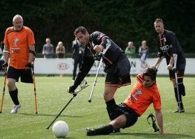 Disable men playing football.