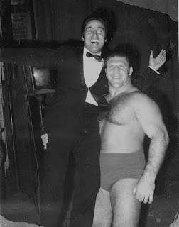 The Neapolitan singer Mario Trevi gets a lift from world champion Sammartino in New York