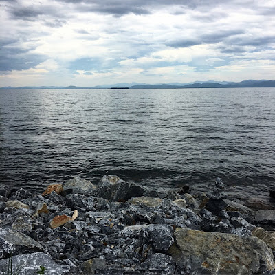 Lake Champlain with rocks in the foreground