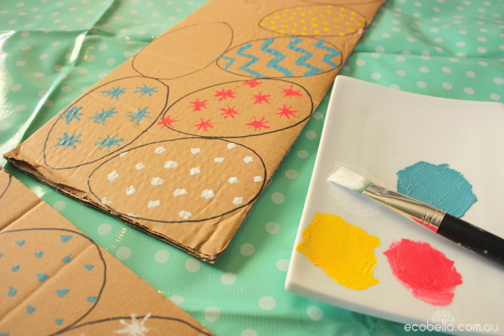 painting and decorating cardboard eggs for a chocolate free hunt