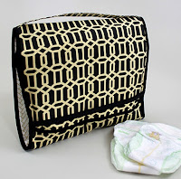 http://theinspiredwren.blogspot.com/2016/04/tutorial-on-the-go-diaper-caddy-changing-pad.html