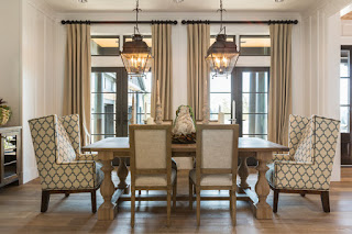 Innovative Chandeliers in the Dining Room with Brown Upholstered Dining Chairs and Long Wooden Table near it