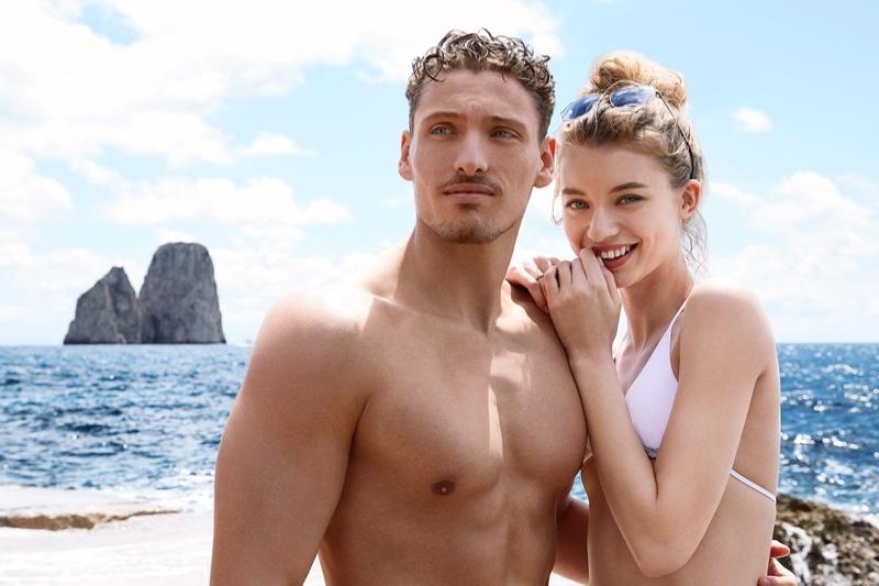 Models Giulia Maenza and Gennaro Lillio embrace in Dolce & Gabbana Light Blue Sun fragrance campaign