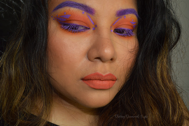 Orange arancio smokey, purple viola lilla eyeliner, orange lips