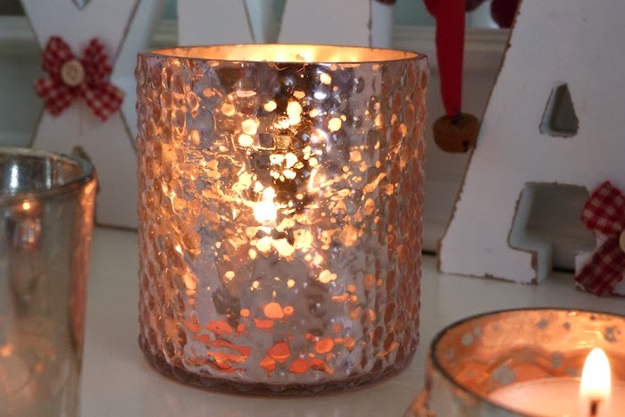an image of pink lustre candle holders