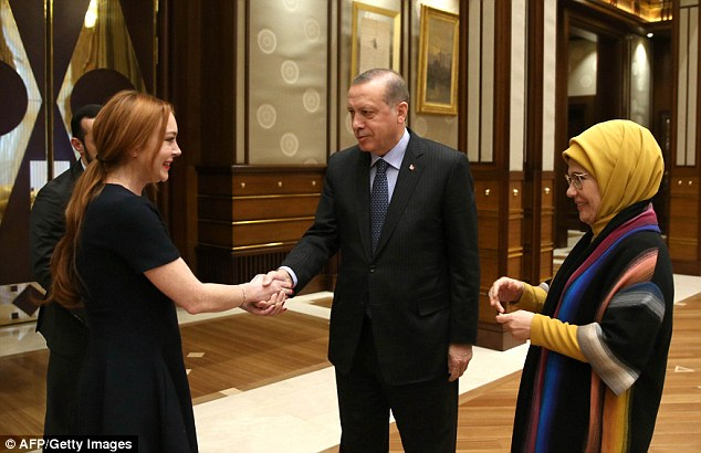 US actress Lindsay Lohan, shakes hands with Turkish President Recep Tayyip Erdogan, and his wife during a visit at the presidential palace