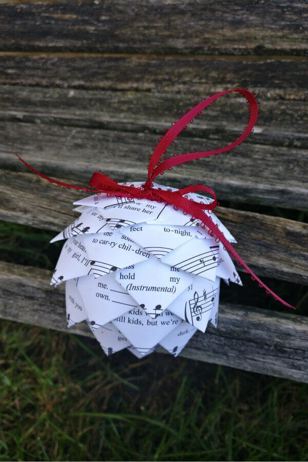 sheet music pine cone tree ornament with red hanging ribbon